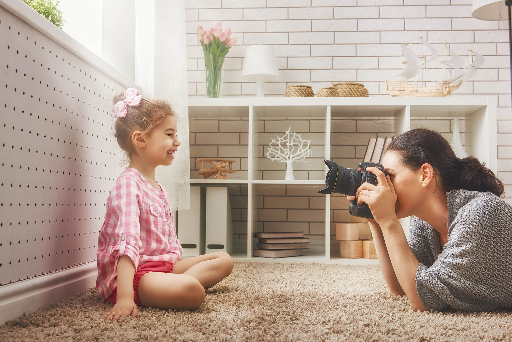 mother taking a portrait of her daughter iphotography